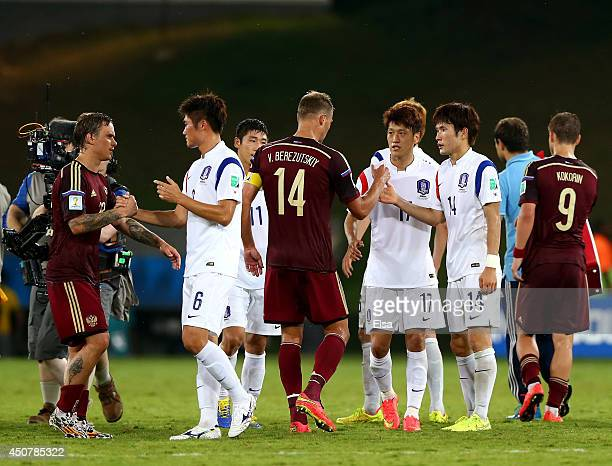 Russia and Korea players interact after their 11 draw in the 2014 FIFA World Cup Brazil Group H match between Russia and South Korea at Arena...