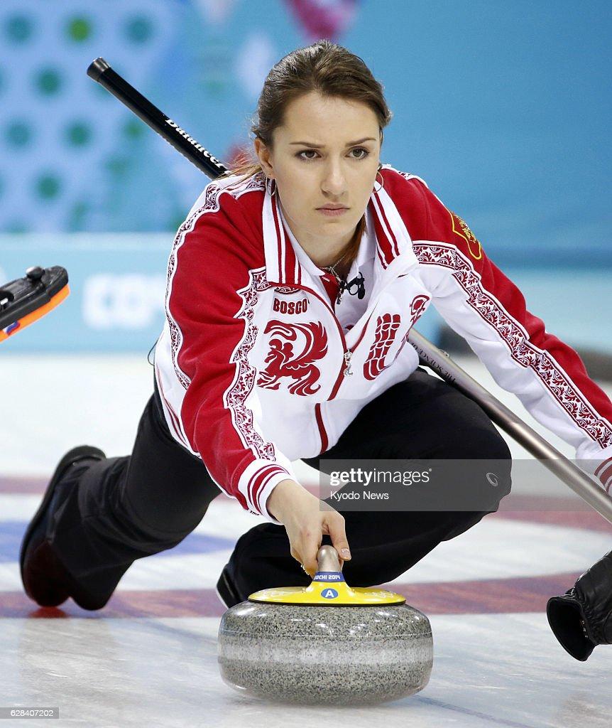 SOCHI, Russia - Anna Sidorova of Russia releases the stone ...