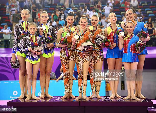 Russia Belgium and Belarus pose with their medals after the Women's Acrobatic Gymnastics Group Dynamic Final on day nine of the Baku 2015 European...