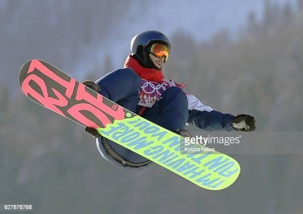 SOCHI Russia Billy Morgan of Britain balances himself midair during his first performance in the snowboard slopestyle qualification round at the...
