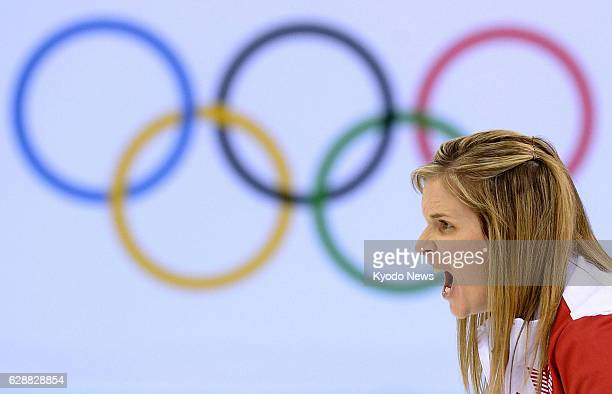 SOCHI Russia Canada's skip Jennifer Jones shouts instructions during the women's curling final against Sweden at the Winter Olympics in Sochi Russia...