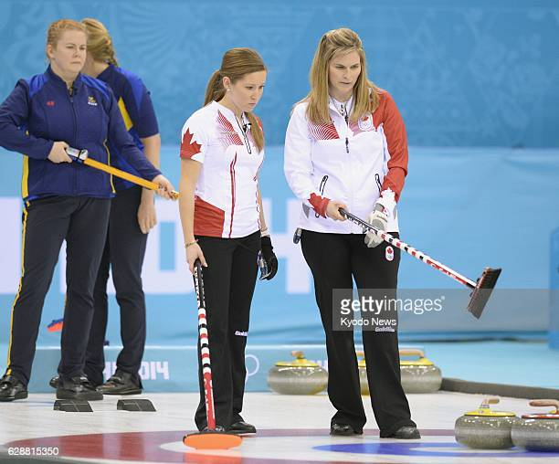 SOCHI Russia Canadian skip Jennifer Jones and vice skip Kaitlyn Lawes check stone positions during the second end of the women's curling gold medal...