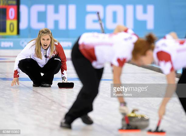 SOCHI Russia Canadian skip Jennifer Jones shouts out instructions after she released the stone during the first end of the women's curling gold medal...