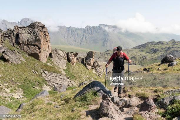 russia, caucasus, mountaineer hiking in upper baksan valley - kaukasus geografische lage stock-fotos und bilder