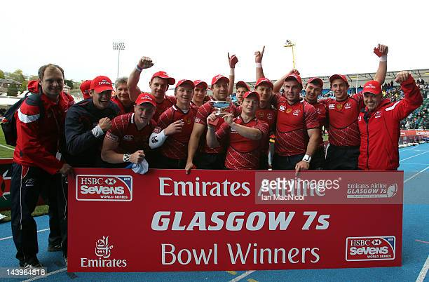 Russia celebrate with the Bowl after defeating Spain during day two of the IRB Glasgow Sevens at Scotstoun Stadium on May 6 2012 in Glasgow Scotland