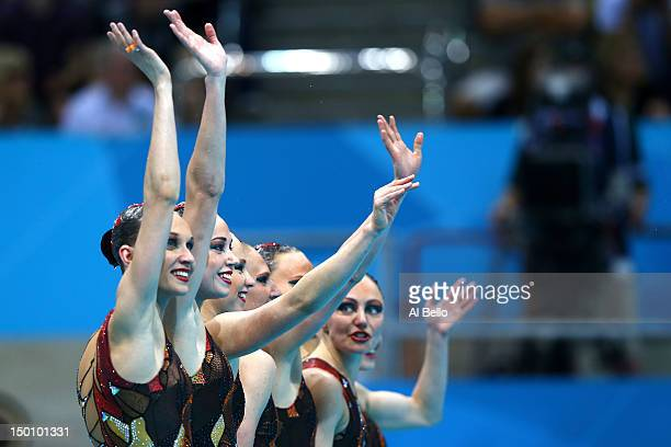 Russia celebrates completing their routine in the Women's Teams Synchronised Swimming Free Routine final on Day 14 of the London 2012 Olympic Games...