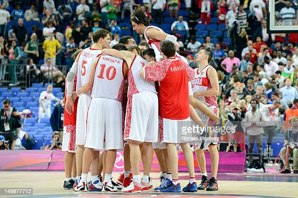 Russia celebrates their 8374 victory against Lithuania during the Men's Basketball quaterfinal game on Day 12 of the London 2012 Olympic Games at...
