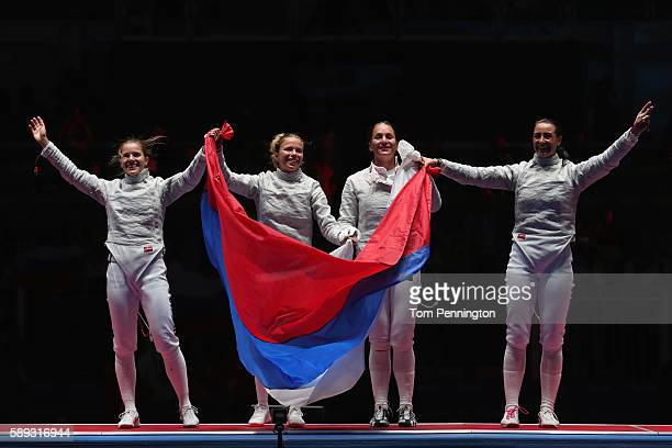 Russia celebrates winning gold after the Women's Sabre Team gold medal match between Russia and Ukraine on Day 8 of the Rio 2016 Olympic Games at...