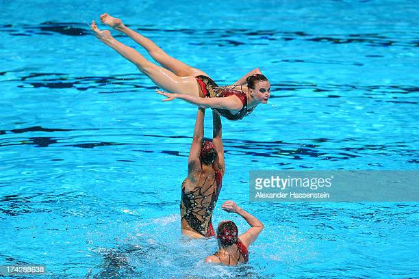 Russia compete in the Synchronized Swimming Team preliminary round on day four of the 15th FINA World Championships at Palau Sant Jordi on July 23...