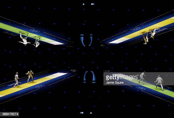 Russia competes against Ukraine and Italy competes against Switzerland during the Men's Epee Team Fencing Quarterfinals at the 2016 Rio Olympic Games...