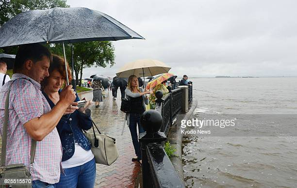 KHABAROVSK Russia CORRECTING ADDING DATE Visitors to a riverside park in Khabarovsk in the Russian Far East on Aug 18 take photos of the Amur River...