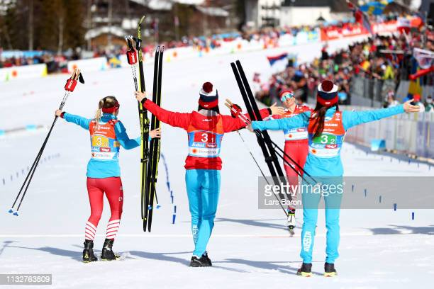 Russia cross the line to finish in third place and claim the Bronze medal during the Women's Cross Country Relay at the FIS Nordic World Ski...
