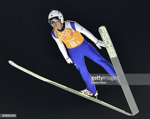 SOCHI Russia Daiki Ito of Japan flies through the air during his first jump in the men's team ski jumping competition at the RusSki Gorki Jumping...