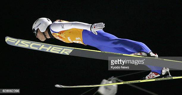 SOCHI Russia Daiki Ito of Japan glides through the air during his first jump in the men's team ski jumping competition at the Sochi Winter Olympic...