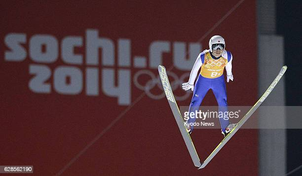SOCHI Russia Daiki Ito of Japan soars through the air in his second jump in the men's team ski jumping event at the RusSki Gorki Jumping Center...