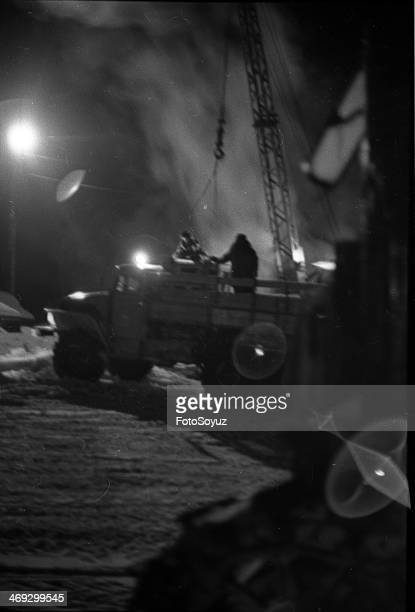 Russia, Dalny Vostok, Chukotka, 1970s: In Chukchi remote places - Baranihe, A minus 54 degree, Unloading of lorry convoys.