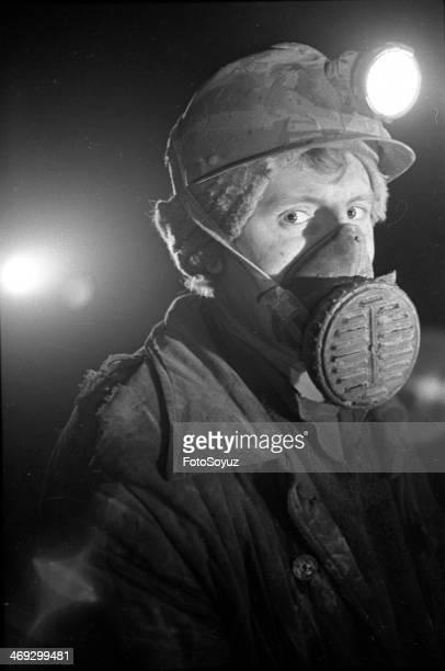 Russia, Dalny Vostok, Chukotka, 1970s: The getter of tin Sergey Sharafanov in a respirator, In a face, Mine Valkumej, Chukotka.