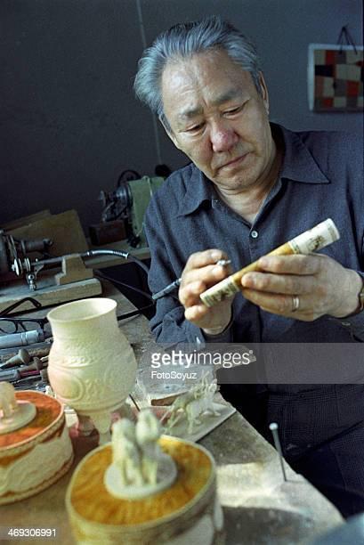 Russia, Dalny Vostok, Sakha , 1970s: Bone carver T Amosov, 1979.