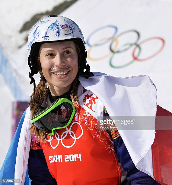 SOCHI Russia Eva Samkova of the Czech Republic sporting a handpainted mustache as her lucky charm is pictured after winning the women's snowboard...
