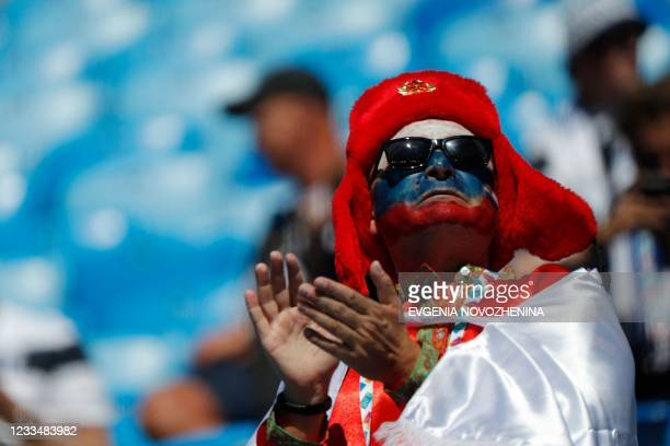 Russia fan attends the UEFA EURO 2020 Group B football match between Finland and Russia at the Saint Petersburg Stadium in Saint Petersburg on June...