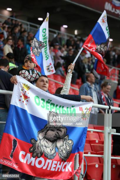Russia fan holds a flag during the FIFA Confederations Cup Russia 2017 Group A match between Russia and Portugal at Spartak Stadium on June 21 2017...