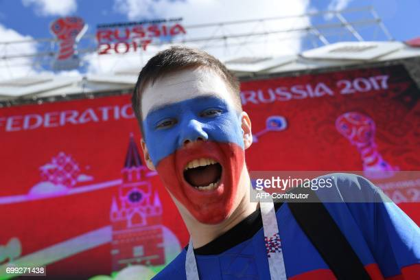 A Russia fan poses ahead of the 2017 Confederations Cup group A football match between Russia and Portugal at the Spartak Stadium in Moscow on June...