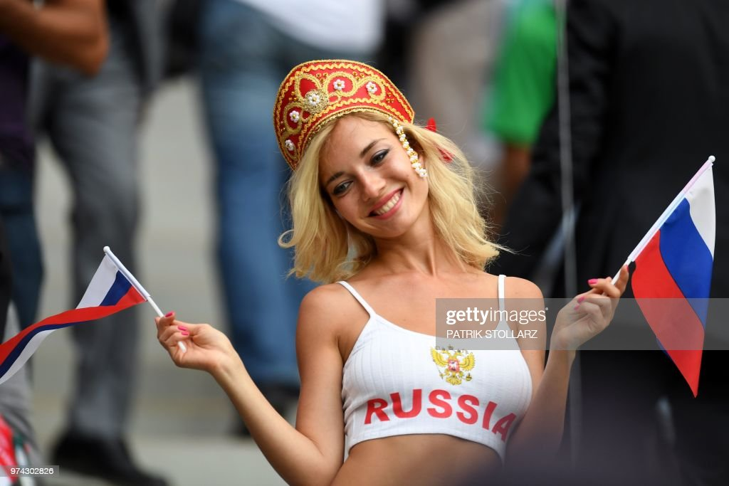 Russia fan poses before the start of the Russia 2018 World Cup Group A football match between Russia and Saudi Arabia at the Luzhniki Stadium in Moscow on June 14, 2018. (Photo by Patrik STOLLARZ / AFP) / RESTRICTED