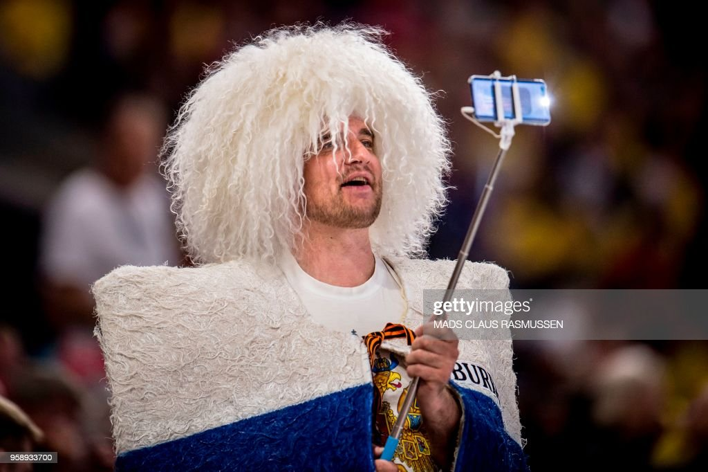 A Russia fan takes a selfie during the IIHF World Championship group A ice hockey match between Russia and Sweden in Royal Arena in Copenhagen, on May 15, 2018. (Photo by Mads Claus Rasmussen / Ritzau Scanpix / AFP) / Denmark OUT