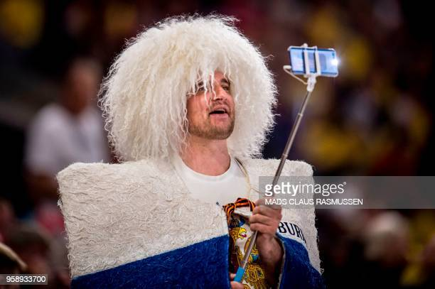 A Russia fan takes a selfie during the IIHF World Championship group A ice hockey match between Russia and Sweden in Royal Arena in Copenhagen on May...