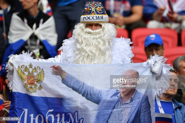 A Russia fan waits for the start of the 2017 Confederations Cup group A football match between Mexico and Russia at the Kazan Arena Stadium in Kazan...