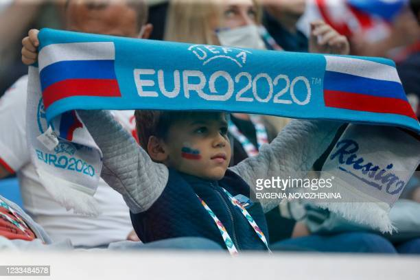 Russia fans attend the UEFA EURO 2020 Group B football match between Finland and Russia at the Saint Petersburg Stadium in Saint Petersburg on June...