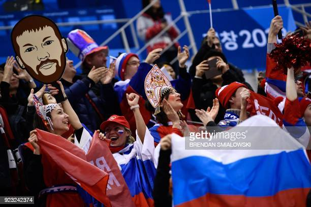TOPSHOT Russia fans celebrate a goal by Russia's Nikita Gusev in the men's semifinal ice hockey match between the Czech Republic and the Olympic...