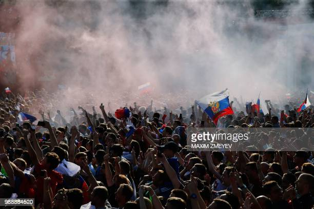 Russia fans celebrate Russia's forward Artem Dzyuba's goal while watching a live telecast of the Russia 2018 World Cup round of 16 football match...