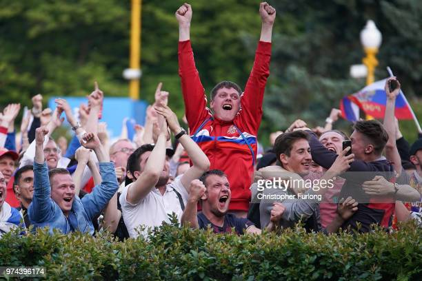 Russia fans celebrate their team's second goal in the first World Cup match between Russia and Saudi Arabia at the official FIFA Fan Fest at Moscow...