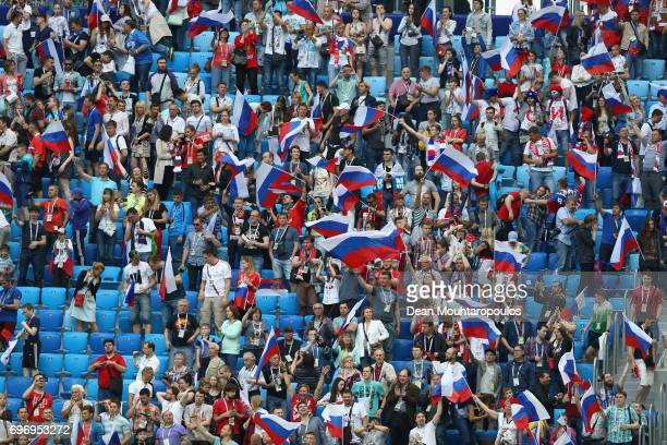 Russia fans cheer on their team during the FIFA Confederations Cup Russia 2017 Group A match between Russia and New Zealand at Saint Petersburg...