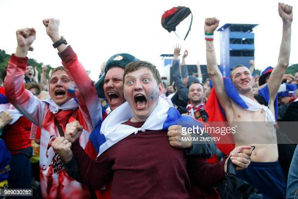 TOPSHOT Russia fans react after Russia won the penalty shootout during the Russia 2018 World Cup round of 16 football match between Spain and Russia...