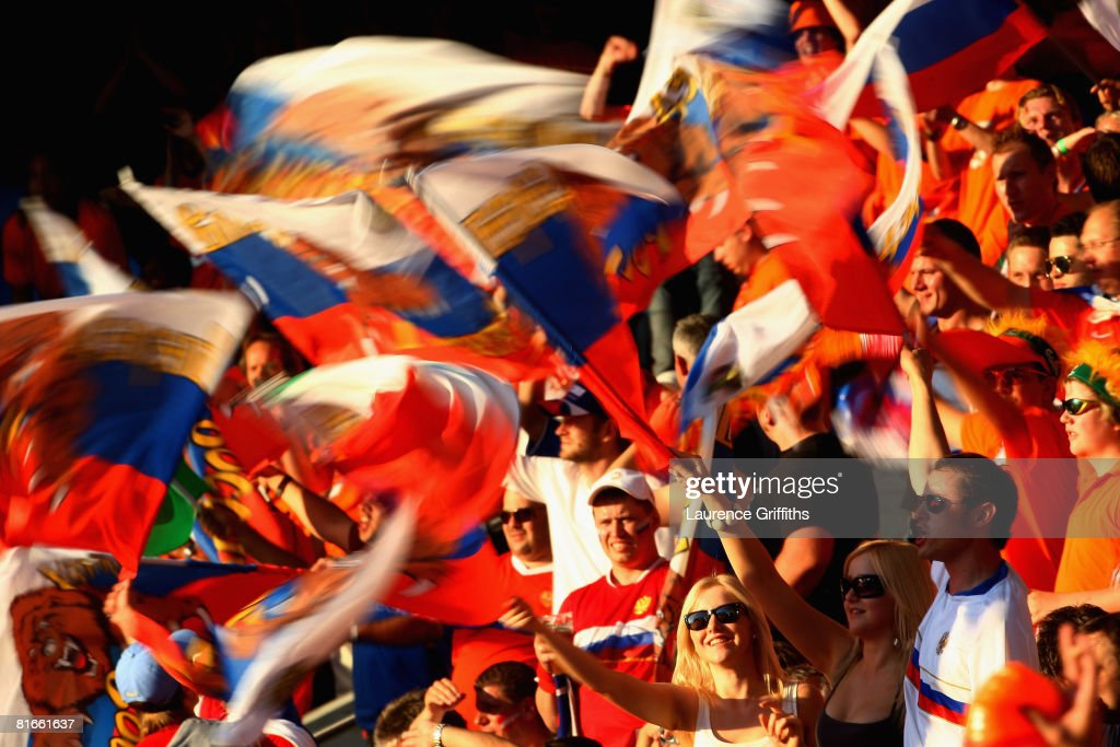 Russia fans wave flags ahead of the UEFA EURO 2008 Quarter Final match between Netherlands and Russia at St. Jakob-Park on June 21, 2008 in Basel, Switzerland.