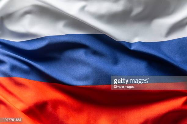 russia flag blowing in the wind. - moscow russia stock pictures, royalty-free photos & images