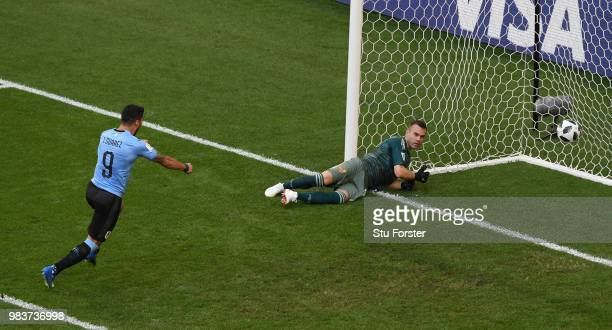 Russia goalkeeper Igor Akinfeev reacts as Luis Suarez of Uruguay celebrates the second goal scored by Diego Laxalt during the 2018 FIFA World Cup...