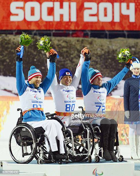 SOCHI Russia Gold medalist Takeshi Suzuki of Japan silver medalist Philipp Bonadimann and bronze medalist Roman Rabl both of Austria celebrate during...