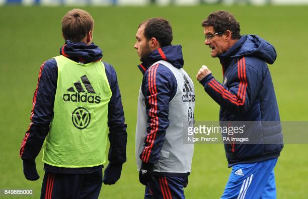 Russia Head Coach Fabio Capello talks to his players during a training session at Stamford Bridge London