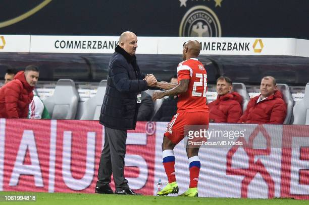 Russia head coach Stanislav Cherchesov and Ferreira Ari of Russia during International Friendly match between Germany and Russia at Red Bull Arena on...