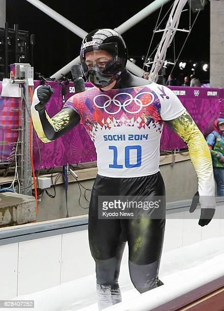 Russia - Hiroatsu Takahashi of Japan pumps his fist after finishing his run in the men's skeleton Heat 4 at the Sanki Sliding Center during the...