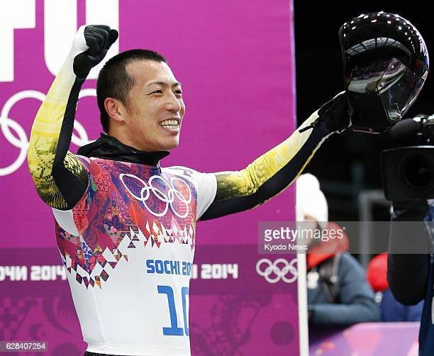 Russia - Hiroatsu Takahashi of Japan responds to the crowd after finishing his run in the men's skeleton Heat 4 at the Sanki Sliding Center during...