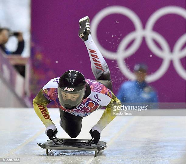 Russia - Hiroatsu Takahashi of Japan starts in the first heat of the men's skeleton at the Sanki Sliding Center in the Sochi Olympic Games in Russia...