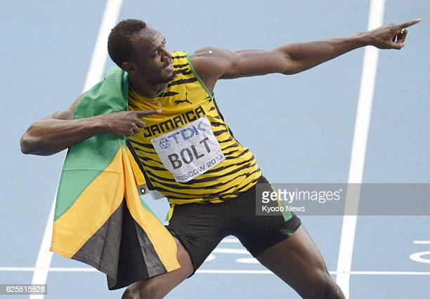 MOSCOW Russia Jamaican sprinter Usain Bolt strikes his trademark pose after winning the men's 200 meters at the world athletics championships in...