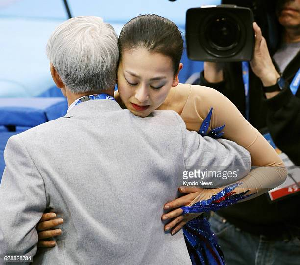 SOCHI Russia Japanese figure skater Mao Asada hugs her coach Nobuo Sato after performing her free program in the women's singles competition at the...
