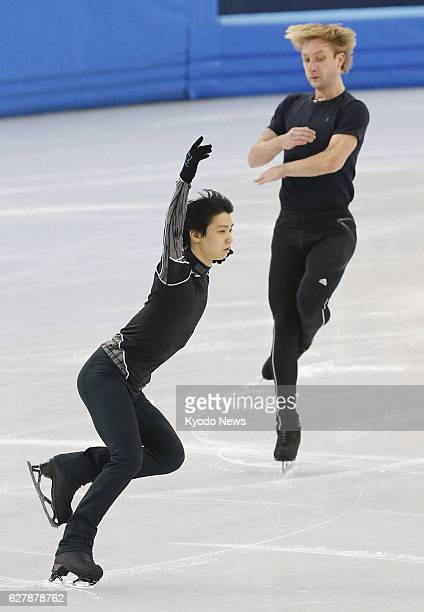 SOCHI Russia Japanese figure skater Yuzuru Hanyu and his Russian rival Evgeni Plushenko skate in an official practice session for the Sochi Olympic...