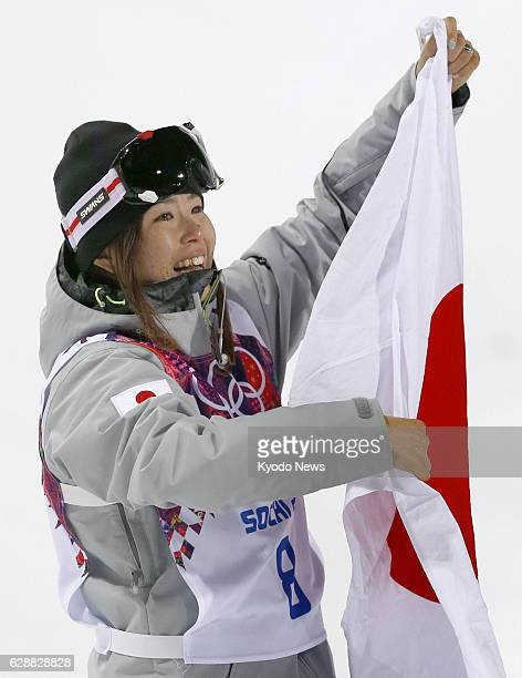 SOCHI Russia Japanese freestyle skier Ayana Onozuka shows her country's national flag with tears of joy on her cheeks after winning the bronze medal...