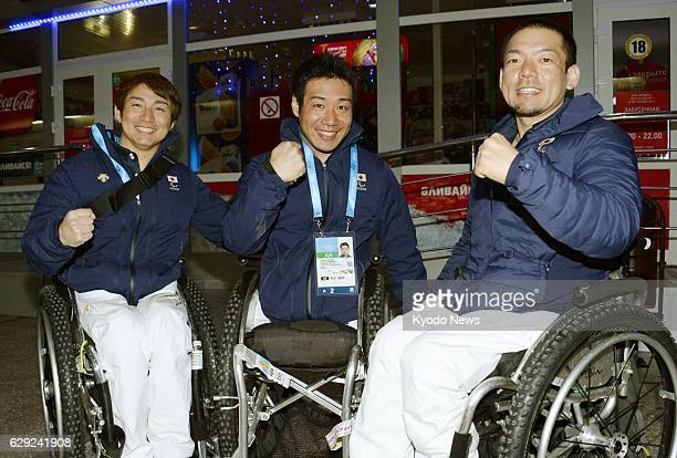 SOCHI Russia Japanese Paralympic alpine skiers pose at Sochi International Airport in the early hours of March 2 after arriving in the Russian city...